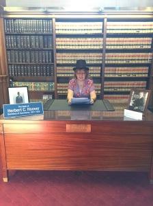 Reading at Hoover's Desk